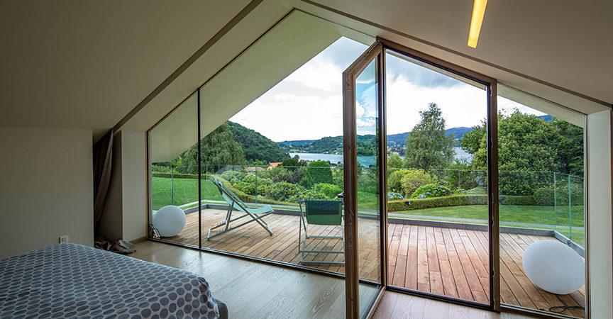 L 39 uso del vetro nelle case in legno stile ed efficienza for Vetrate case moderne