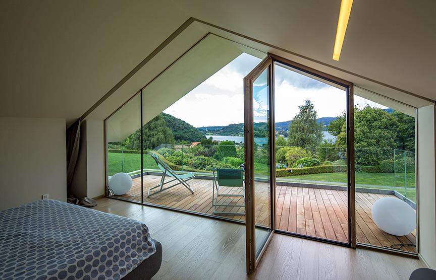 Kager-case-in-legno-vetrate-vista-lago